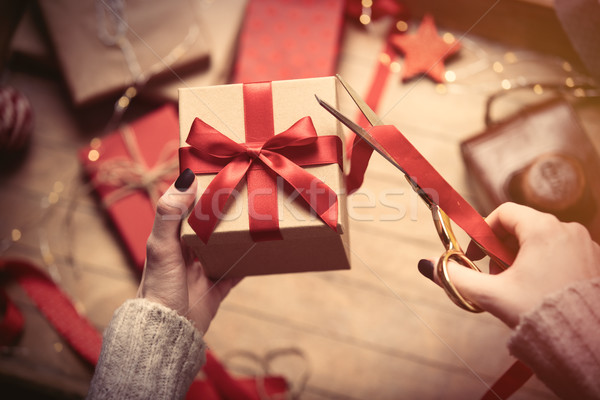 hands wrapping gift Stock photo © Massonforstock