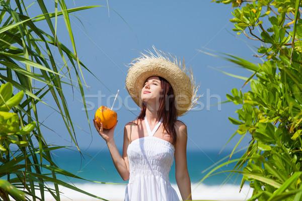 Belo mulher jovem em pé areia praia Foto stock © Massonforstock
