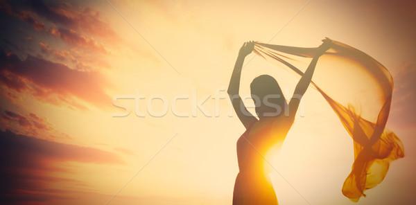 photo of beautiful young woman with shawl on the wonderful sunse Stock photo © Massonforstock