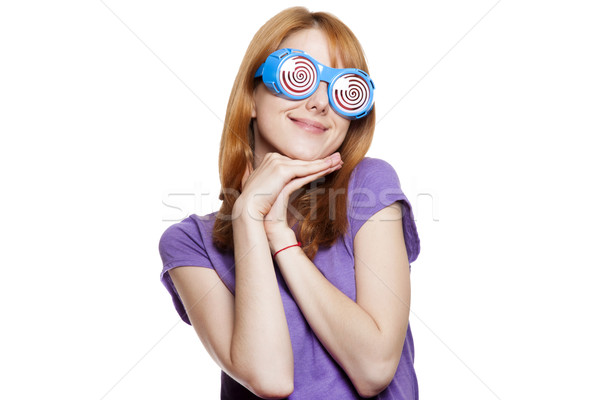 Redhead girl with funny glasses Stock photo © Massonforstock