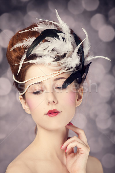 Redhead girl with Rococo hair style at vintage background. Photo Stock photo © Massonforstock