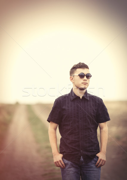 Young man in sunglasses at countryside outdoor. Stock photo © Massonforstock
