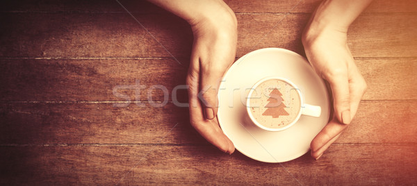 Female hands holding cup of coffee. Stock photo © Massonforstock