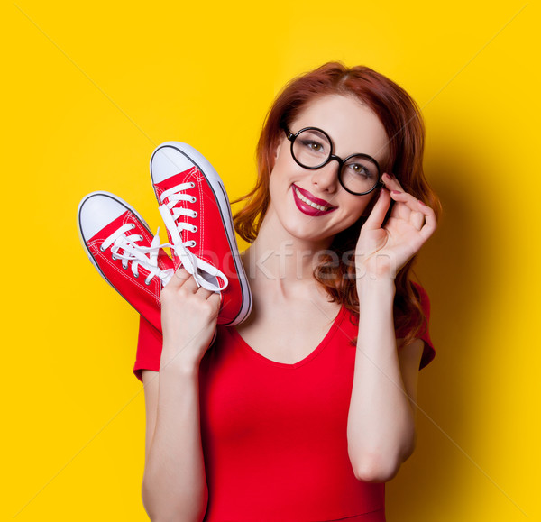 girl in red dress with gumshoes Stock photo © Massonforstock
