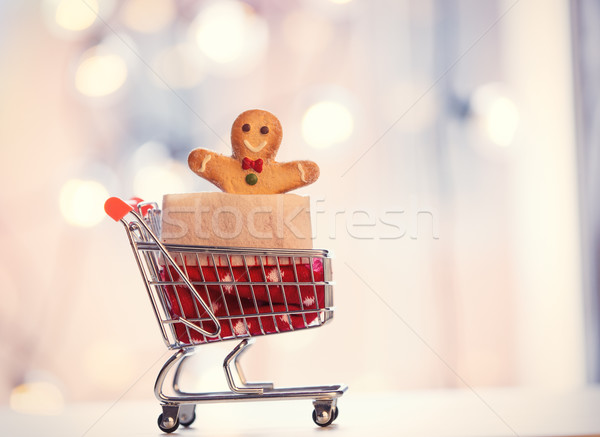 Shopping cart and gingerbread man  Stock photo © Massonforstock
