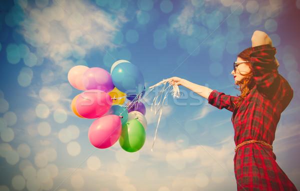 Gyönyörű fiatal nő színes léggömbök csodálatos égbolt Stock fotó © Massonforstock