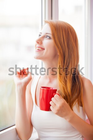 Güzel genç kadın fincan pencere kahve şehir Stok fotoğraf © Massonforstock