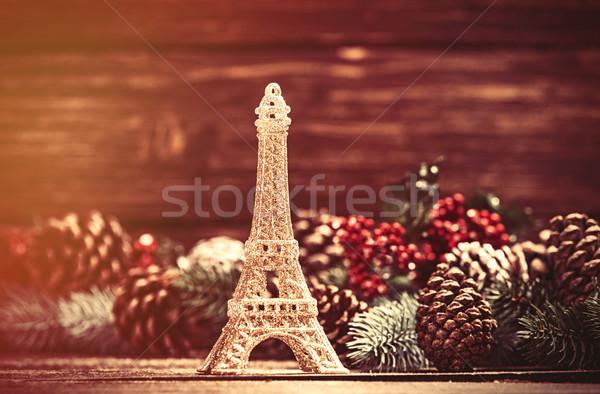 Eiffel-torony játék fenyőfa ágak asztal háttér Stock fotó © Massonforstock