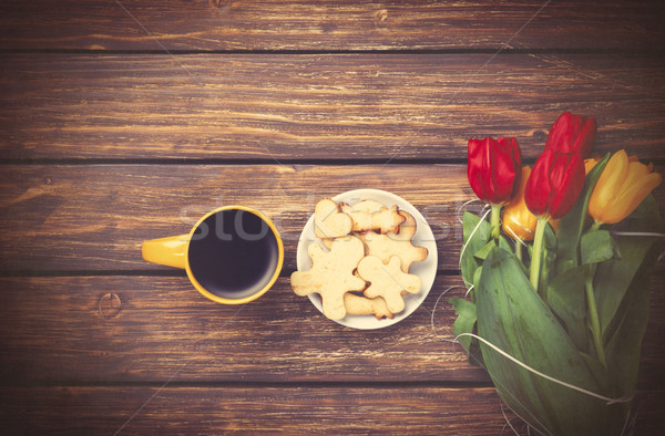 Cup of coffee and tulips with cookies  Stock photo © Massonforstock