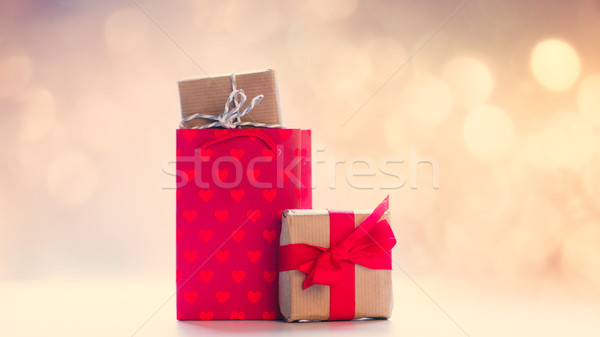 cool shopping bag and beautiful gifts on the fairy lights bokeh  Stock photo © Massonforstock