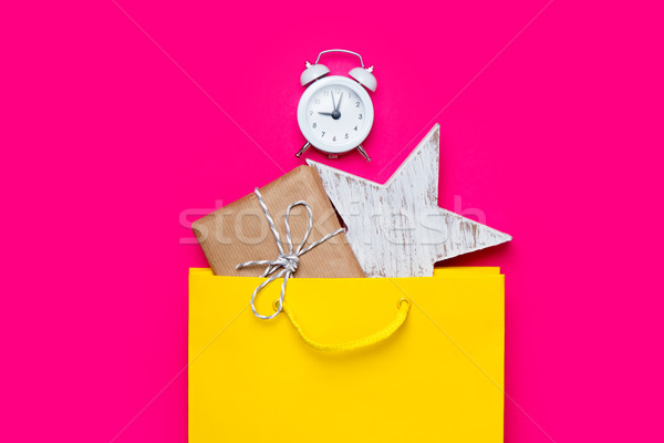 cute gift, alarm clock and star shaped toy in beautiful yellow s Stock photo © Massonforstock