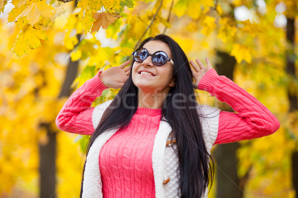 photo of beautiful young woman on the wonderful yellow trees bac Stock photo © Massonforstock