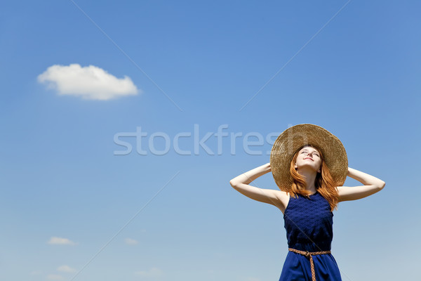 Redhead girl at spring blue sky background. Stock photo © Massonforstock