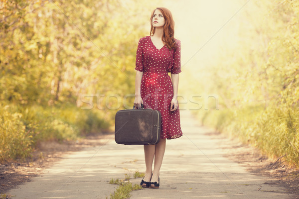 Kız bavul ağaçlar geçit kadın Stok fotoğraf © Massonforstock