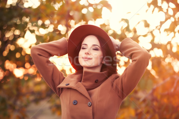 Woman in hat and coat Stock photo © Massonforstock
