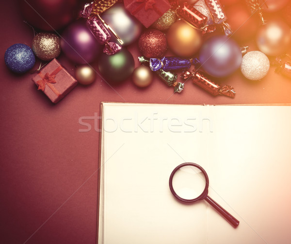 Loupe and book near christmas toys. Stock photo © Massonforstock