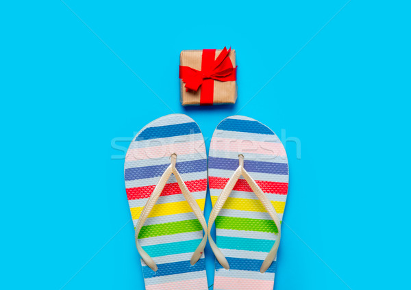 colorful sandals and beautiful gift on the wonderful blue backgr Stock photo © Massonforstock