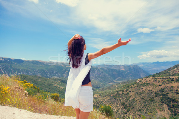 beautiful young woman standing in front of splendid mountain bac Stock photo © Massonforstock