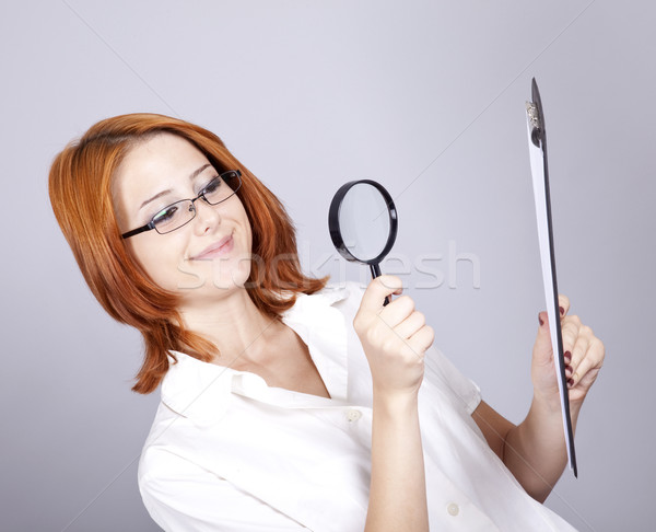 Young businesswomen with white plan board and loupe Stock photo © Massonforstock