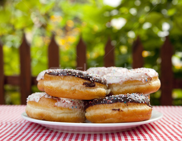 A couple of donuts on table. Stock photo © Massonforstock