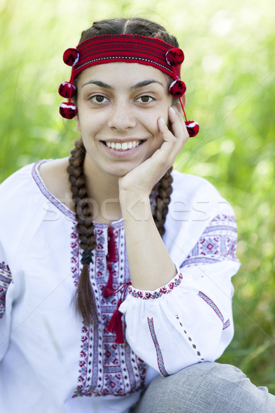 Slav girl at green meadow. Stock photo © Massonforstock