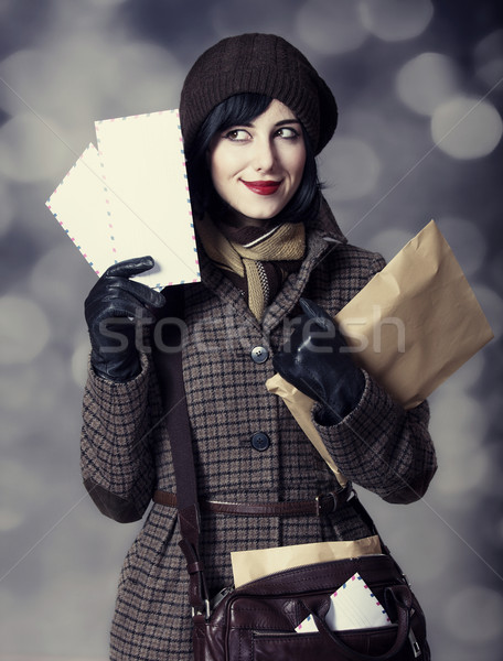 Young postman girl with mail. Photo in old color style with boke Stock photo © Massonforstock