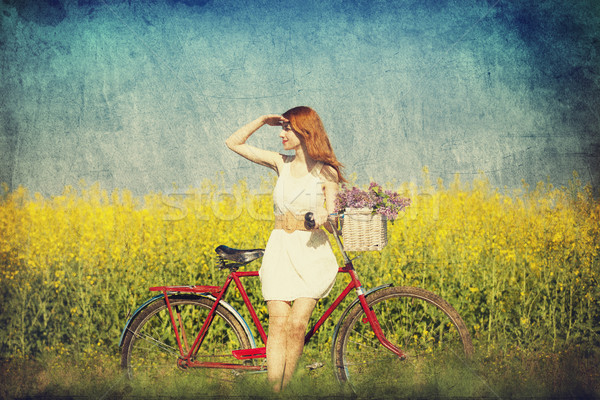 Girl on a bike in the countryside. Stock photo © Massonforstock