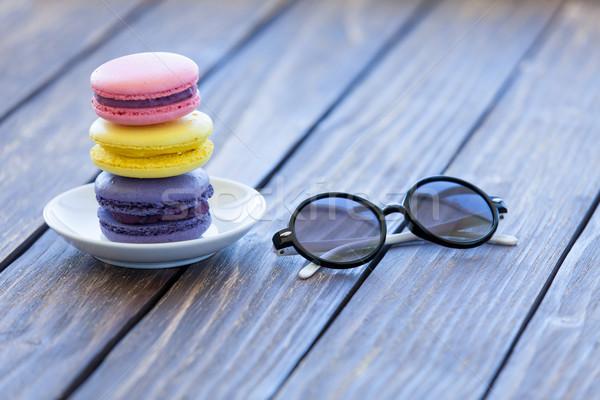 Macarons мало ноутбук очки деревянный стол текстуры Сток-фото © Massonforstock