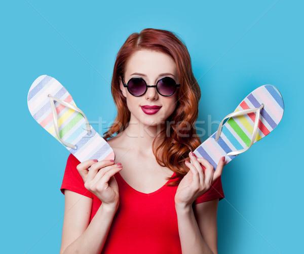 Lány vörös ruha papucs boldog napszemüveg kék Stock fotó © Massonforstock