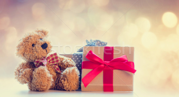 cute teddy bear and beautiful gifts on the fairy lights bokeh ba Stock photo © Massonforstock
