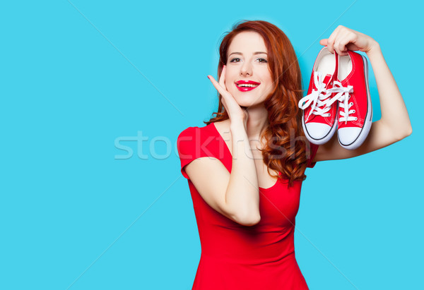 photo of beautiful young woman with red gumshoes on the wonderfu Stock photo © Massonforstock