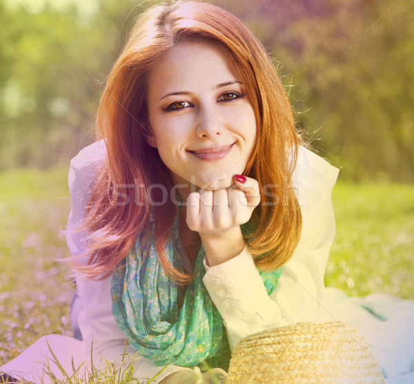 Redhead girl at grass in the park. Photo in multicolor style. Stock photo © Massonforstock