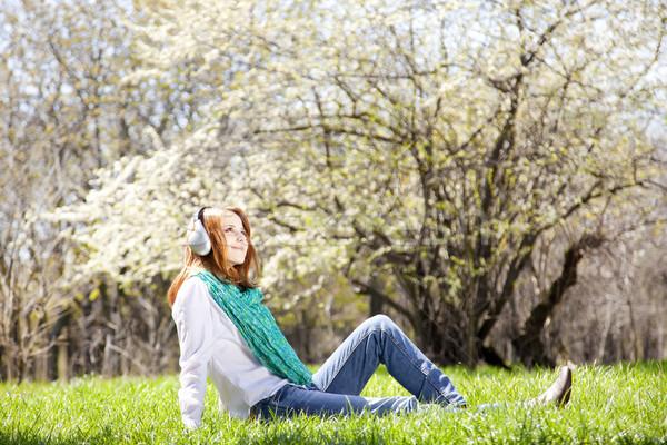Vörös hajú nő lány fejhallgató park zene fa Stock fotó © Massonforstock