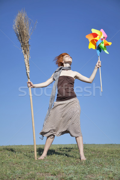 Young witch at green field with broom and wind turbine  Stock photo © Massonforstock