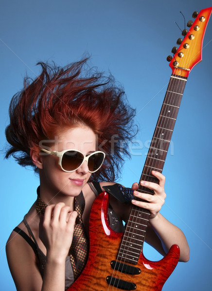 Stock photo: Fashion girl with guitar