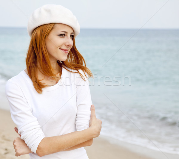 Young beautiful girl walking at the beach Stock photo © Massonforstock