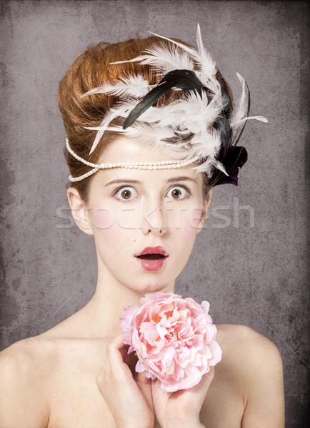 Meglepődött vörös hajú nő lány hajstílus virág klasszikus Stock fotó © Massonforstock
