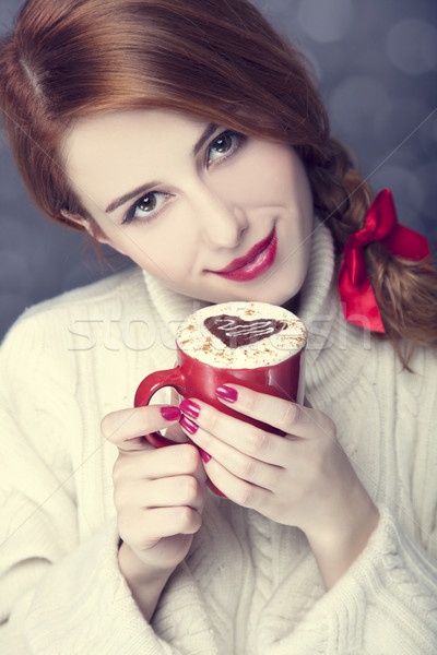 Redhead girl with red coffee cup at. St. Valentine's Day Stock photo © Massonforstock