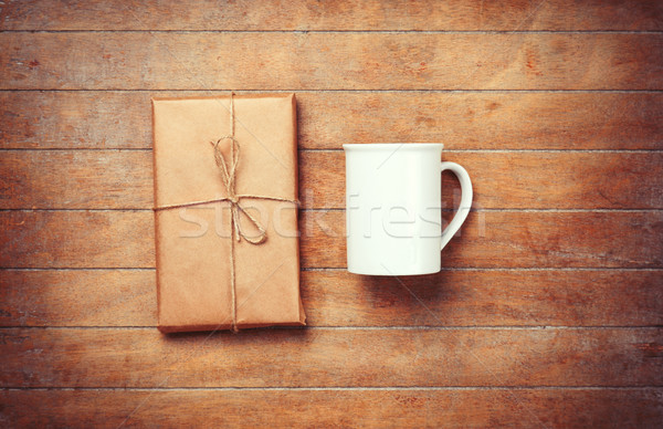 White cup and package on wooden table.  Stock photo © Massonforstock