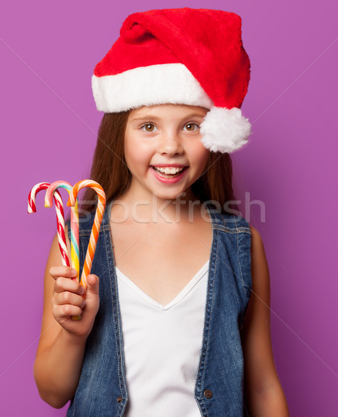 girl in red Santas hat with candy  Stock photo © Massonforstock