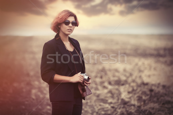 Style young women with camera  Stock photo © Massonforstock