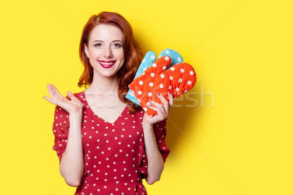 Mädchen roten Kleid Fäustlinge lächelnd Rotschopf rot Stock foto © Massonforstock