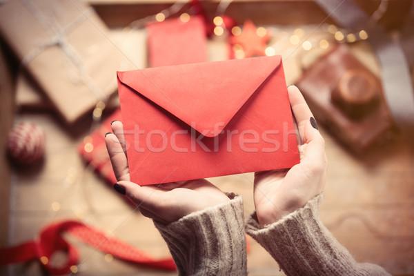 hands holding envelope Stock photo © Massonforstock