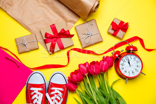 bunch of red tulips, red gumshoes, cool shopping bag, alarm cloc Stock photo © Massonforstock