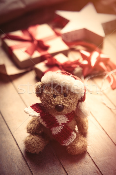 cute gifts, star shaped toy, teddy bear in santa claus hat and t Stock photo © Massonforstock