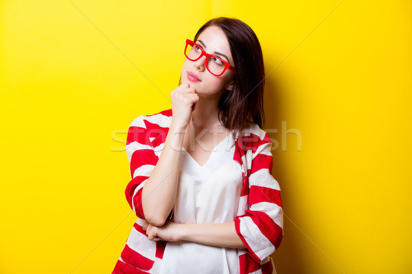 beautiful young woman in glasses standing in front of wonderful  Stock photo © Massonforstock