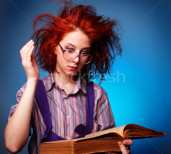 Young wizard girl with old magic book  Stock photo © Massonforstock