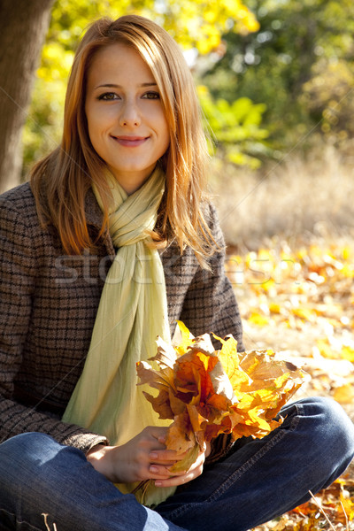 Portrait of red-haired girl in the autumn park Stock photo © Massonforstock
