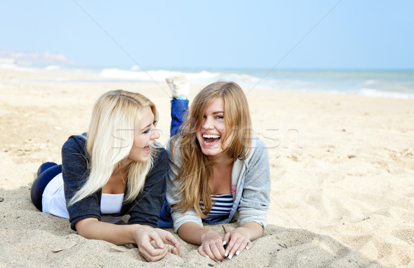 Stock photo: Two girls at outdoor near sea.
