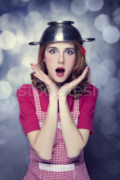 Redhead housewife with colander over head Stock photo © Massonforstock